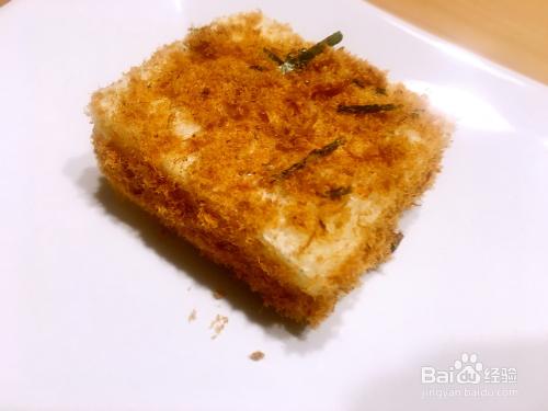 你买现成的海苔肉松,也买泡菜,然后拌碎的海苔制作.最简单的备用肉松图片