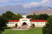 The Hadley Hall administration building and the distant mountain Austria Geng